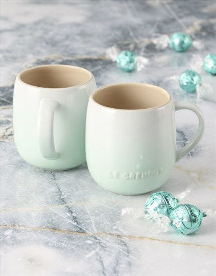 Picture of Mint Green Le Creuset Mugs and Chocolate